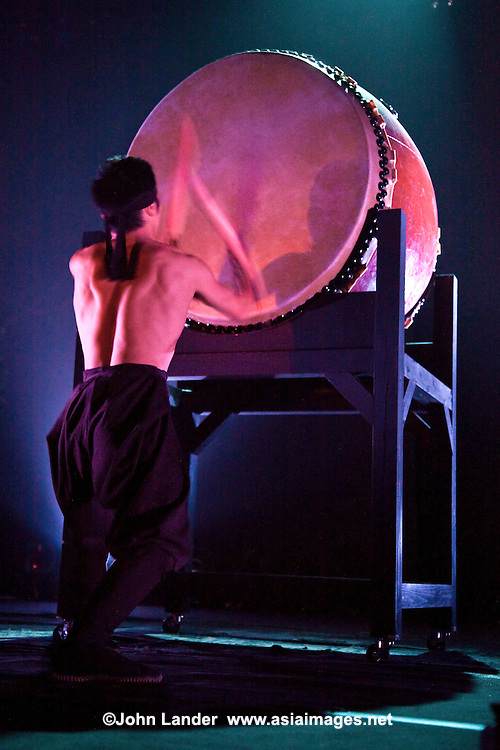 """Taiko Drummer - Taiko means """"drum"""" in Japanese and to the relatively recent art form of ensemble taiko drumming or more specifically """"kumi-daiko"""".  Performances can last up to 25 minutes and typically follow a rapid/ sudden/urgent structure; the performance speeds up significantly towards the grand finale."""