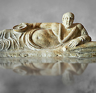 Close up of an Etruscan Hellenistic style cinerary, funreary, urn cover with a man,  National Archaeological Museum Florence, Italy , grey art background .<br /> <br /> If you prefer to buy from our ALAMY PHOTO LIBRARY  Collection visit : https://www.alamy.com/portfolio/paul-williams-funkystock - Scroll down and type - Etruscan Florence - into LOWER search box. (TIP - Refine search by adding a background colour as well).<br /> <br /> Visit our ETRUSCAN PHOTO COLLECTIONS for more photos to download or buy as wall art prints https://funkystock.photoshelter.com/gallery-collection/Pictures-Images-of-Etruscan-Historic-Sites-Art-Artefacts-Antiquities/C0000GgxRXWVMLyc