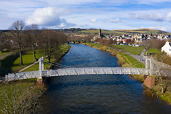 View of suspension bridge crossing River Tweed in town of Peebles in the Scottish Borders, Scotland,UK