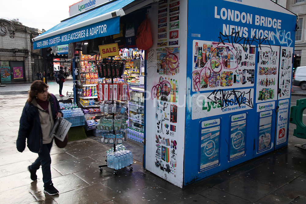 London Bridge news kiosk on 27th November 2019 in London, England, United Kingdom. This small shop has been situated here for years and sells snacks, drinks, and mobile phone accessories.
