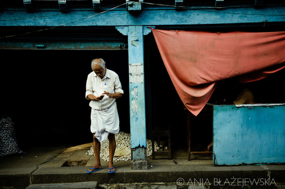 India, Kochi. Trader of Bazaar Road.<br /> <br /> Kochi was known for a long time as the main centrum of Indian spice trade. Although today it's only a shadow of its former glory, walking on Bazaar Road in Mattancherry still it's possible to feel its atmosphere, meet the traders of famous  specialities of Kerala, visit old Indian ginger factory  and smell the Indian spices.