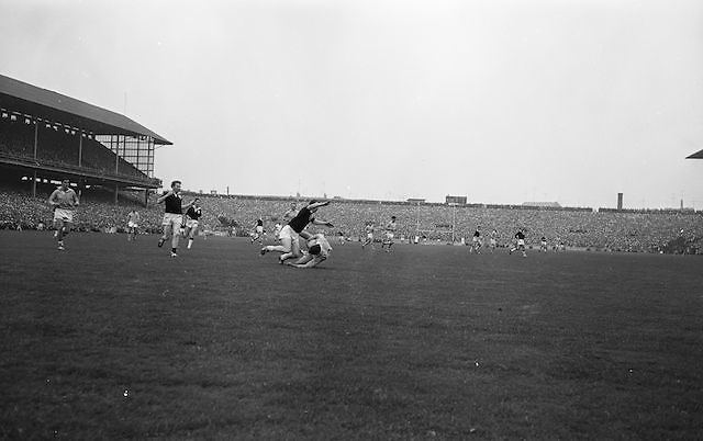 Galway and Dublin players collide in a tackle during All Ireland Senior Gaelic Football Championship Final Dublin V Galway at Croke Park on the 22nd September 1963. Dublin 1-9 Galway 0-10.
