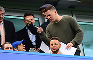 Channing Tatum, the American actor points the way as he goes to his seat to watch the game. Premier league match, Chelsea v Arsenal at Stamford Bridge in London on Sunday 17th September 2017.<br /> pic by Andrew Orchard sports photography.