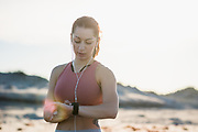 Woman in her twenties working out during an early morning on the beach in Newport, Rhode Island