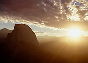 Morning sun washes over Half Dome and the Sierra Mountains, Yosemite National Park, CA.
