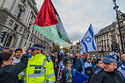 The March is stopped by an Israeli protest and the groups are seperated y a police cordon - National Palestine March and Rally - Justice Now: Make it right for Palestine. As the centenary of the Balfour Declaration has just passed on the 2nd November. Speakers addressed the crowd at Grosvenor Square (by the US Embassy) before the march through central London (via Piccadilly Circus and Trafalgar Square). This was followed by a rally in Parliament Square, where speakers again addressed the crowd.