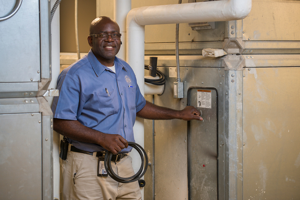 Houston ISD plant operator Roy Giles poses for a photograph, July 24, 2014.