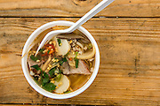 Queens, NY - October 2, 2016. Thai noodle soup served up by Pata Paplean at The Feastival of Queens at The Meadows Festival at Citi Field.