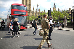 May 24, 2017 - London, London, United Kingdom - Image ©Licensed to i-Images Picture Agency. 24/05/2017. London, United Kingdom. Increased Security in London's Westminter. The British Army patrol the streets in WESTMINSTER , Due to the terror alert level being increased to critical after the recent terror attack in Manchester, security in the capital has been stepped up with army being deployed in key areas. Picture by Dinendra Haria / i-Images (Credit Image: © Dinendra Haria/i-Images via ZUMA Press)