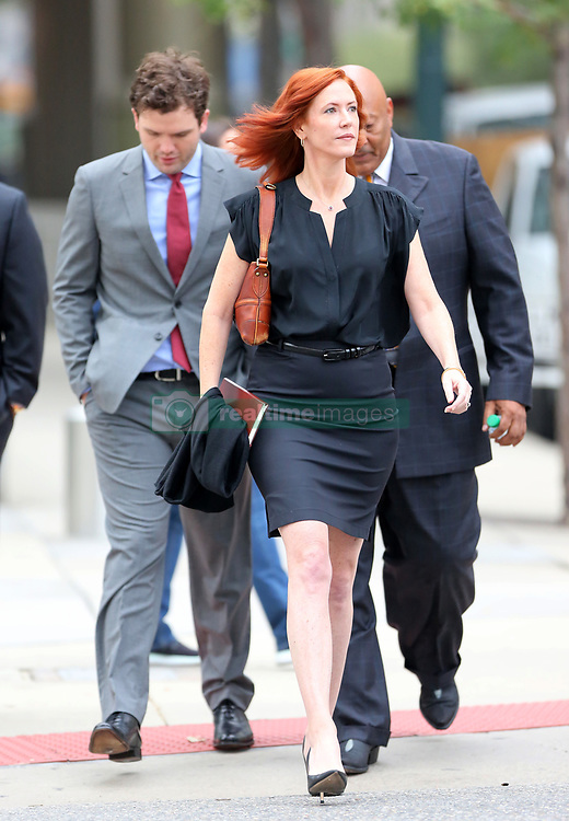 """Taylor Swift v David Mueller trial in Denver day five arrivals at court. Pictured Taylor Swift's brother, Austin, publicist Tree Paine and security detail leaving the Ritz-Carlton hotel to walk to the nearby courthouse. Also sign in a nearby office window that reads """"FEARLESS."""". 11 Aug 2017 Pictured: Taylor Swift's brother, Austin Swift, publicist Tree Paine. Photo credit: Leigh Green/MEGA TheMegaAgency.com +1 888 505 6342"""