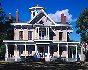 Historic Kelley Mansion with visitors on steps.  Mansion built by Datus Kelley from 1861 to 1865, National Historic Register, Kelleys Island, Lake Erie, Ohio.