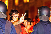 A young man with the sign of peace in a protest movement that was mainly pacific