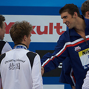 Paul Biedermann of Germany, who won the silver medal in the Men's 4x 100m Medley relay event, shakes hands with Michael Phelps of USA who won gold at the World Swimming Championships in Rome, Italy on Sunday, August 2, 2009. Photo Tim Clayton..