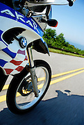 BMW F650 GS Dakar riding at speed down the Talimena Scenic Highway in SE Oklahoma.  Front wheel, depicts speed.