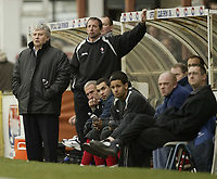 Photo: Aidan Ellis.<br /> Grimsby Town v Swindon Town. Coca Cola League 2. 17/03/2007.<br /> Swindon's manager Paul Sturock and his backroom staff look concerned watching the game