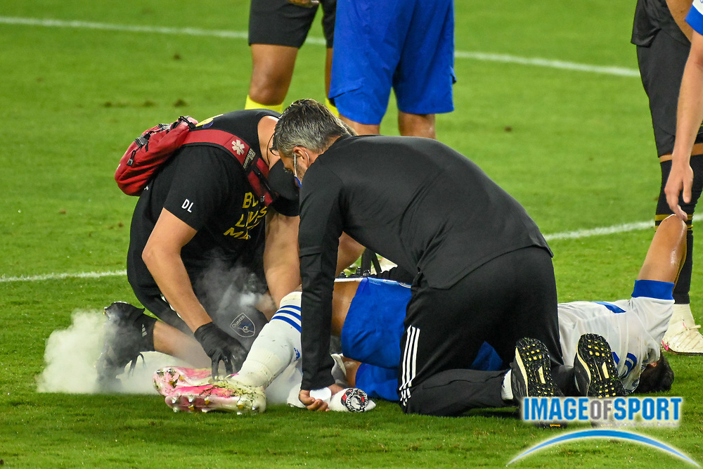 San Jose Earthquakes forward Andres Rios (25) is tended to by Earthquakes medical staff during a MLS soccer game, Sunday, Sept. 27, 2020, in Los Angeles. The San Jose Earthquakes defeated LAFC 2-1.(Dylan Stewart/Image of Sport)