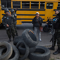 A soldier instructs another to film the photographer as tyres are taken from protestors in a demonstration against fraud in the capital Tegucigalpa
