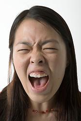 Studio portrait of a teenage girl shouting,