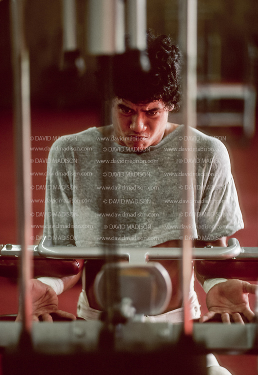 COLLEGE FOOTBALL:  A Stanford football player works out in the weight room, September 1981, Stanford University, Palo Alto, California.  Photograph by David Madison   www.davidmadison.com.
