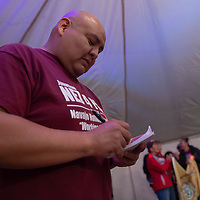 Jeremy McCabe, 34, tallies the election results as KGAK radio broadcasts them during the Navajo Nation Presidential election on Tuesday in Window Rock.