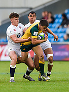Australia centre Liam Jurd is held by England centre  Johnny Williams and centre Joe Marchant during the World Rugby U20 Championship  match England U20 -V- Australia U20 at The AJ Bell Stadium, Salford, Greater Manchester, England on June  15  2016, (Steve Flynn/Image of Sport)