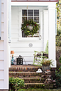 A Christmas wreath decorates a porch on a historic home along King Street in Charleston, SC.
