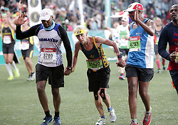 10062018 (Durban) Annie in the middle making her way to the finnish line at the Mosses Mabhida stadium venue during the Comrades Marathon on Sunday as Bong'musa Mthembu and Ann Ashworth ensured that the coveted titles remained on these shores.<br /> Picture: Motshwari Mofokeng/African News Agency/ANA