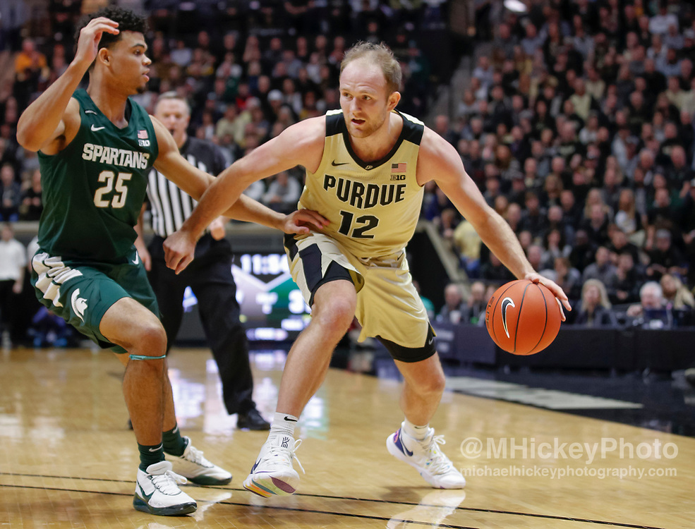 WEST LAFAYETTE, IN - JANUARY 12: Evan Boudreaux #12 of the Purdue Boilermakers dribbles the ball against Malik Hall #25 of the Michigan State Spartans at Mackey Arena on January 12, 2020 in West Lafayette, Indiana. (Photo by Michael Hickey/Getty Images) *** Local Caption *** Evan Boudreaux; Malik Hall