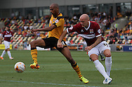 Chris Zebroski of Newport (left) shields the ball from Ryan Cresswell of Northampton. Skybet football league two match, Newport county v Northampton Town at Rodney Parade in Newport, South Wales on Saturday13th Sept 2014<br /> pic by Mark Hawkins, Andrew Orchard sports photography.