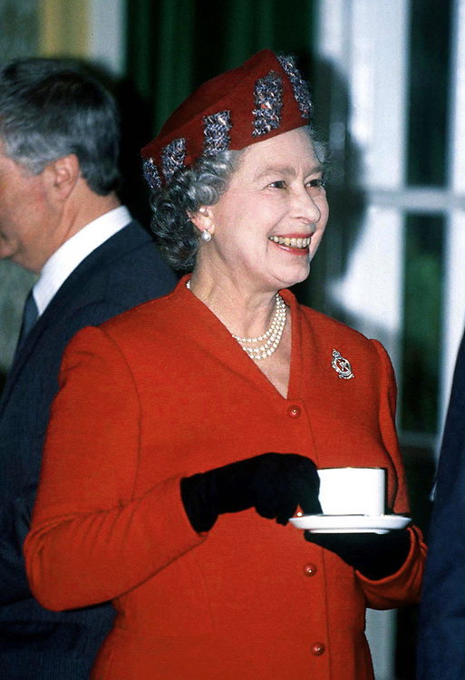 THE QUEEN SEEN DRINKING TEA DURING A VISIT TO RAF RAYNHAM.UK.MARCH 1991. PHOTO BY JAYNE FINCHER.