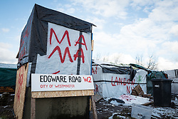 © London News Pictures. Calais, France. 07/03/16. A hand-painted 'Edgware Road W2' sign leans against a shelter that is to be demlished this week. French authorities are evicting and demolishing the southern half of the Calais 'Jungle' camp, which charities estimate to contain 3,500 people. . Photo credit: Rob Pinney/LNP