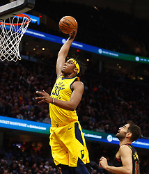April 18, 2018 - Cleveland, OH, USA - The Indiana Pacers' Myles Turner drives for a dunk against the Cleveland Cavaliers' Jose Calderon in the first quarter of Game 2 of a first-round NBA playoff series on Wednesday, April 18, 2018, at the Quicken Loans Arena in Cleveland. (Credit Image: © Leah Klafczynski/TNS via ZUMA Wire)