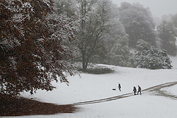 © Licensed to London News Pictures. 09/11/2016. Ripon, UK. Walkers brave the heavy snowfall at Fountains Abbey near Ripon in North Yorkshire. The Met Office has issued a severe weather warning as Scotland and much of the North of England has seen heavy snowfall. Photo credit : Ian Hinchliffe/LNP