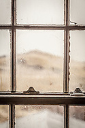 A November Nor'easter blows raindrops into patterns on a window of the C-Scape dune shack.