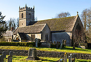 Headstones in graveyard of village parish church of Saint James at Cherhill, Wiltshire, England, UK
