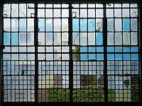 Broken window in a warehouse in Brooklyn.