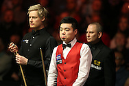 China's Ding Junhui © looks on during his match against Neil Robertson (l) of Australia. . Betvictor Welsh Open snooker 2016, day 5 at the Motorpoint Arena in Cardiff, South Wales on Friday 19th Feb 2016.  <br /> pic by Andrew Orchard, Andrew Orchard sports photography.
