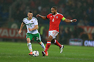 Ashley Williams of Wales goes past Conor Washington of Northern Ireland. Wales v Northern Ireland, International football friendly match at the Cardiff City Stadium in Cardiff, South Wales on Thursday 24th March 2016. The teams are preparing for this summer's Euro 2016 tournament.     pic by  Andrew Orchard, Andrew Orchard sports photography.