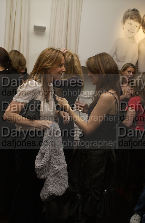 EMILY OPPENHEIMER AND LAUREN BOOTH. A photo exhibition in support of Facing the World <br />