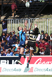 Bjorn Basson of the Blue Bulls and Daniel Demas of Boland challenge for the high ball during the Currie Cup premier division match between the Boland Cavaliers and The Blue Bulls held at Boland Stadium, Wellington, South Africa on the 23rd September 2016<br /> <br /> Photo by:   Shaun Roy/ Real Time Images
