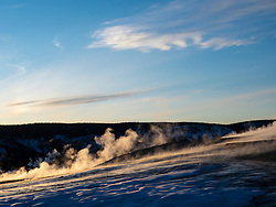 North America, United States, Wyoming, Yellowstone National Park, steam above fumaroles, and snow