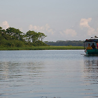 A water taxi pulling into Tortuguero, Costa Rica on April 8, 2009.  The small village is remote and accessed mainly through water taxis.  (Photo/Billy Byrne Drumm)