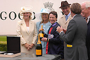 Kieron Fallon being presented with a prize. Glorious Goodwood. 27 July 2005. ONE TIME USE ONLY - DO NOT ARCHIVE  © Copyright Photograph by Dafydd Jones 66 Stockwell Park Rd. London SW9 0DA Tel 020 7733 0108 www.dafjones.com