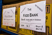 Trussell Trust Food Bank box for a family with three children waiting for distribution in the Wadebridge foodbank, North Cornwall, England, United Kingdom. The box has been prepared by volunteers and contains non-perishable food items.