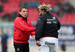 RC Toulon head coach Mike Ford (left) attempts to get out of the way of Mathieu Bastareaud during the warm up before the European Champions Cup, pool three mach at Parc y Scarlets, Llanelli.