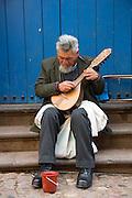 Man playing Charango, Cusco, Urubamba Province, Peru
