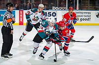 KELOWNA, CANADA - MARCH 13:  Jaret Anderson-Dolan #11 of the Spokane Chiefs checks Kyle Topping #24 of the Kelowna Rockets after the face-off on March 13, 2019 at Prospera Place in Kelowna, British Columbia, Canada.  (Photo by Marissa Baecker/Shoot the Breeze)