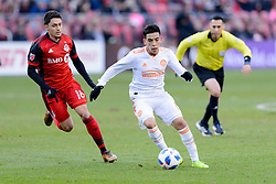 October 28, 2018 - Toronto, ON, U.S. - TORONTO, ON - OCTOBER 28: Marco Delgado (18) of Toronto FC attempts to stop Ezequiel Barco (8) of Atlanta United FC during the first half of the MLS Decision Day match between Toronto FC and Atlanta United FC on October 28, 2018, at BMO Field in Toronto, ON, Canada. (Photograph by Julian Avram/Icon Sportswire) (Credit Image: © Julian Avram/Icon SMI via ZUMA Press)