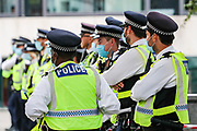 Police wearing face masks stand in front of climate change protestors outside Home Office in Marsham Street, central London on Tuesday, Sept 2, 2020. Ten days of climate change demonstrations have begun as Extinction Rebellion (XR) take to the streets across the UK. (VXP Photo/ Vudi Xhymshiti)