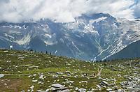 Hikers on Abbott Ridge Trail. Selkirk Mountains Glacier National Park British Columbia